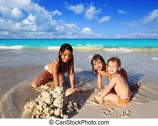 three little girls mixed ethnicity playing beach - three...