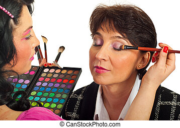 Beautician applying eyeshadow