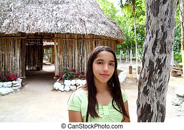 Indian girl in jungle palapa hut house rainforest Latin...