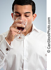 Man tasting drinking wine - Closeup of a professional man...