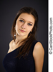 Portrait of a beautiful young woman in evening dress on...