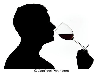 Wine testing - A man in silhouette smelling red wine