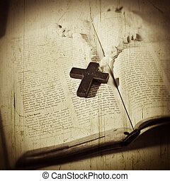 Open Bible with a cross on grunge texture
