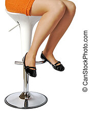 Woman on a stool - A woman sitting on a white design stool...