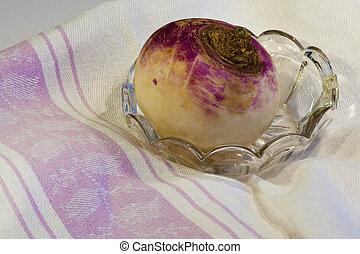 turnip - Violet radish or turnip on a kitchen towel / tea...