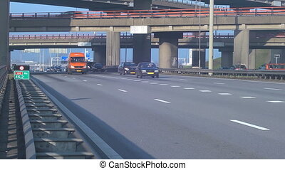 Flowing traffic - Cars and trucks driving past during rush...