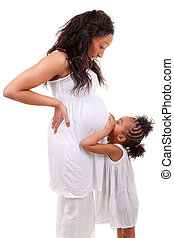 Pregnant woman with her daughter - Pregnant black woman with...