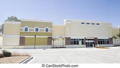 pastel yellow strip mall