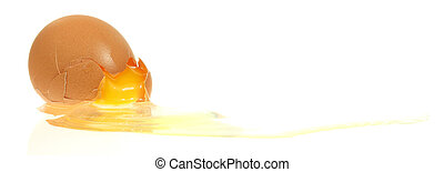 Cracked Egg - A stock photo of a shattered egg with yolk...