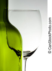 Empty wine glass and a wine bottle