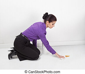 Spilled coffee - Woman wiping spilled coffee from the floor...