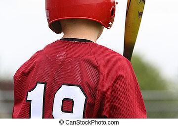 Batter up - A batter up for bat during a game.