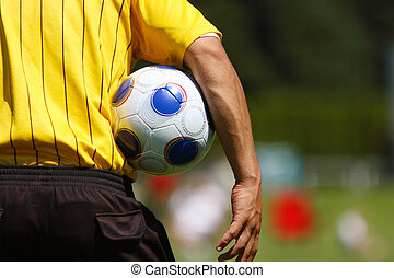 Soccer referee on the field.