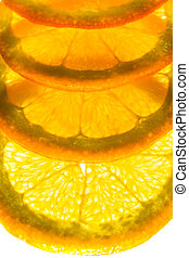 Orange slice overlapped - Four orange slices back lit and...