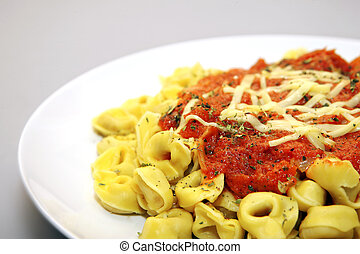 Tortellini with tomato sauce - A close up of tortellini with...