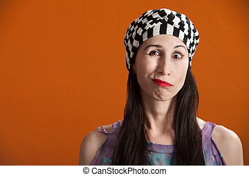 Woman Making Faces - Woman in striped cap and tie-die making...