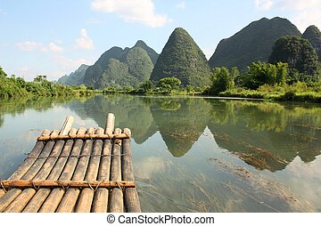 Bamboo rafting on Li-river, Yangsho - Bamboo raft on the...