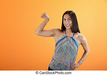 Strong Woman - Strong Latina woman showing off her bicep