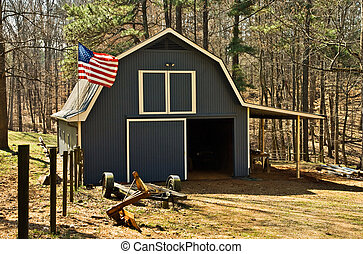 Small Barn with Flag - A small barn beside a pasture with a...