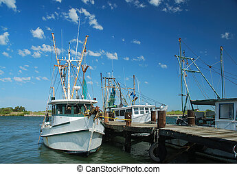 Shrimp Boats at the Dock - Shrimp boat docked after a...