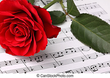 Symphony of love 3 - red rose on music sheet.