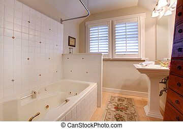 Luxury antique bathroom with white tub and tiles