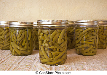 Home canned green beans cooling on the kitchen counter