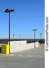 Parking Deck - Top of a parking deck with spaces and light...