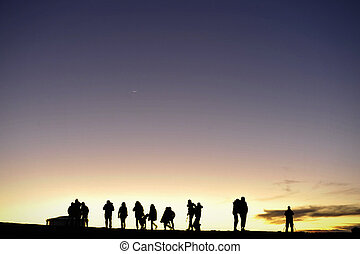 Silhouettes of people against the night sky - Silhouette of...