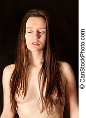 Classical nude of a beautiful young woman with closed eyes...