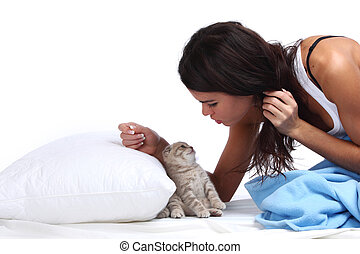 waking woman and cat - waking woman on the white pillow