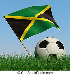Soccer ball in the grass and the flag of Jamaica against the...