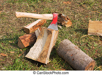 hatchet, cutting firewood, accepts stuck on a piece of wood