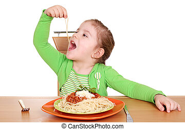 cute little girl eating spaghetti - four years hungry little...