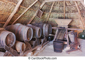old cellar into a thatched hut - old cellar with barrels and...