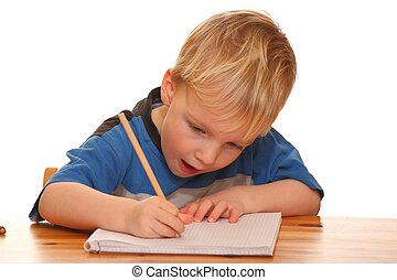 Young boy writing - Portrait of a young boy writing isolated...