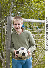 The teenager in collars with a football
