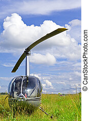 Helicopter on Field solar day