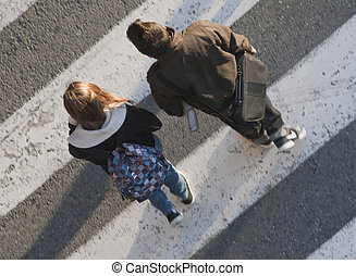 Teenagers after school crossing the street - Couple of...