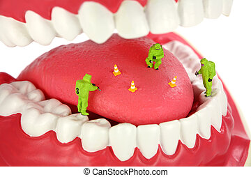 Bad breath concept. Miniature HAZMAT team inspects a tongue...