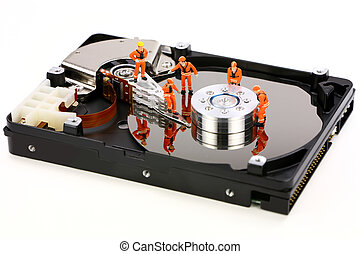 Miniature technicians work on hard drive - Miniature...