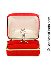 Miniature married couple in red ring box