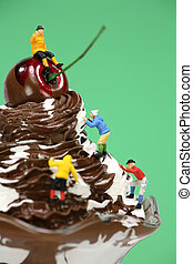 Miniature mountain climbers climbing up an ice cream sundae...