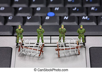 Computer data security concept - Miniature military soldiers...