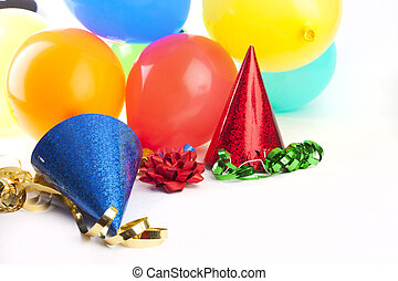 HIGH KEY SHOT OF PARTY HATS AND BALLOONS