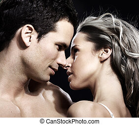 Love couple - Young couple in love Over dark background