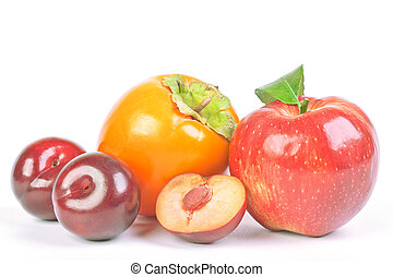 Plums, persimmon and red apple on white background
