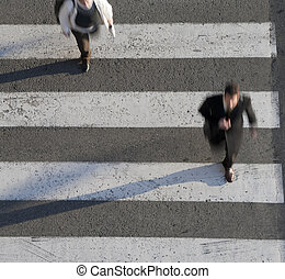 Businessman at rush hour - Businessman crossing the street...