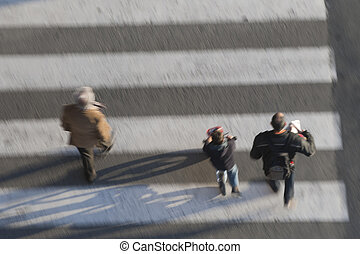 Grandfather, father and child crossing the street - Three...