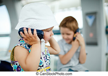 Kids on excursion - Kids listening to audio guide on...